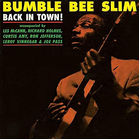 Cover for Bumble Bee Slim's Back in Town album. Man playing guitar on stage.